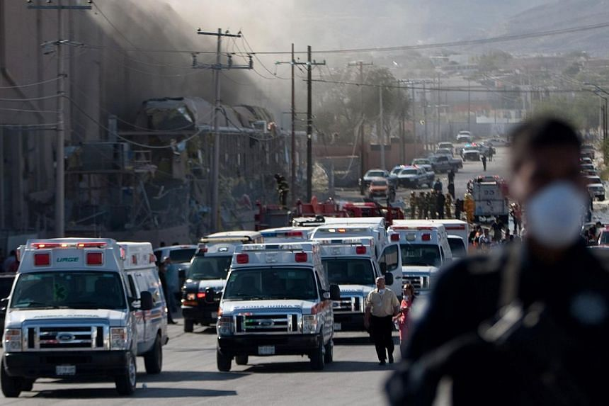 Smoke billows from a United States-owned candy factory in Ciudad Juarez, in northern Mexico, after a boiler exploded on Oct 24, 2013. The huge blas thatt rocked the Blueberry factory caused the ceiling to collapse, injuring more than 40 people and le