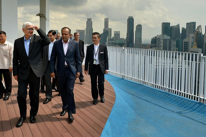 Mr Khurshid (front, left), accompanied by Mr Shanmugam, viewing Singapore's skyline from the 50th-storey Skybridge at the Pinnacle@Duxton yesterday. -- ST PHOTO: KUA CHEE SIONG