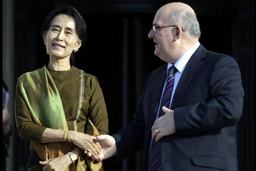 Myanmar opposition leader Aung San Suu Kyi is greeted by Mr Willie Hay, right, current speaker of the Northern Ireland assembly at Parliament Buildings, Belfast on Thursday, Oct 24, 2013. Ms Suu Kyi will be meeting with political leaders where she ho