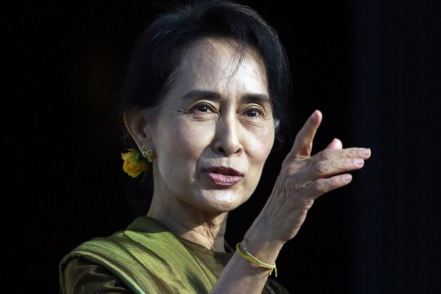 Myanmar pro-democracy leader Aung San Suu Kyi arrives at Parliament buildings on the Stormont estate in Belfast, on Oct 24, 2013. -- PHOTO: REUTERS