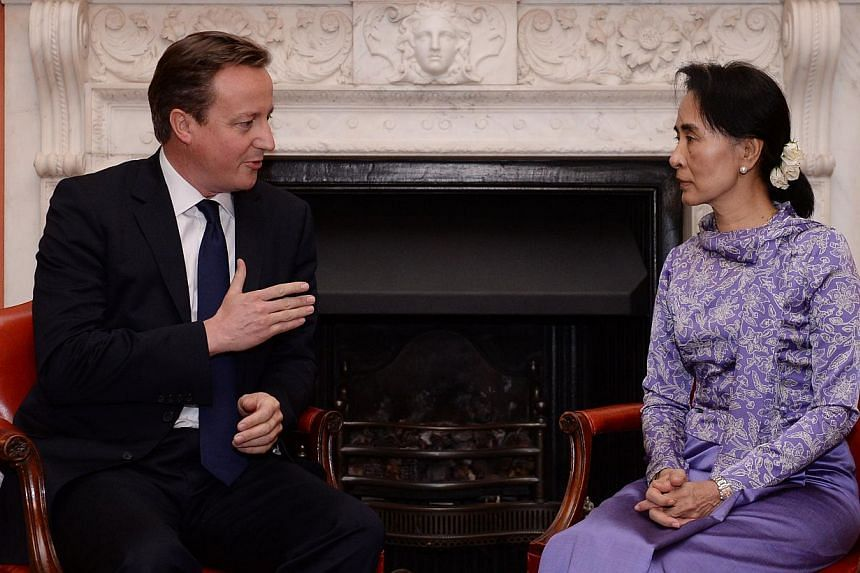 British Prime Minister David Cameron talks with Ms Aung San Suu Kyi (right) inside 10 Downing Street in central London on Oct 23, 2013. -- FILE PHOTO: AFP