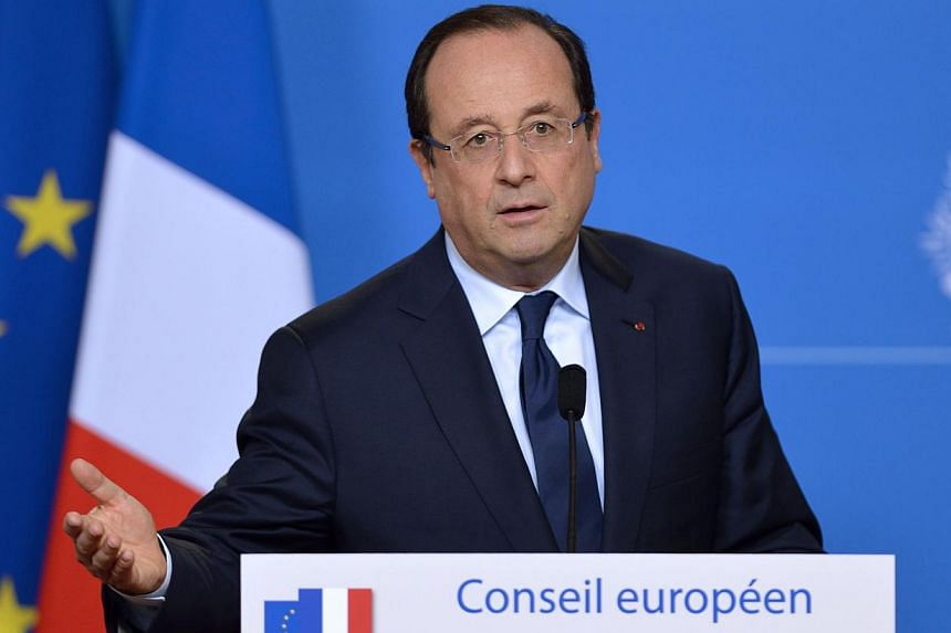President Francois Hollande (above) ruled out any special exemption for France's football clubs as clubs, angered at the country's 75-per cent tax on its highest earners, ready for unprecedented strike action. -- PHOTO: AFP
