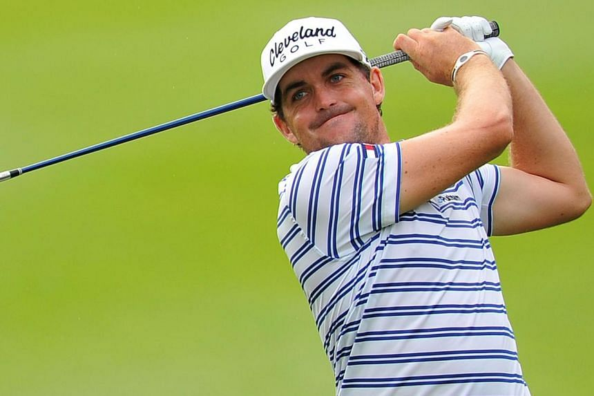 Pinpoint accuracy helped former US PGA champion Keegan Bradley (above) grab a four-shot lead at the halfway stage of the CIMB Classic in Malaysia on Friday, Oct 25, 2013, as Phil Mickelson's swing struggles continued. -- PHOTO: AFP