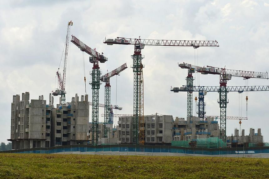 The HDB flats at Waterway Woodcress under construction along Punggol Drive.More public and private homes will be ready for occupation in the next three years. -- ST FILE PHOTO:ASHLEIGH SIM