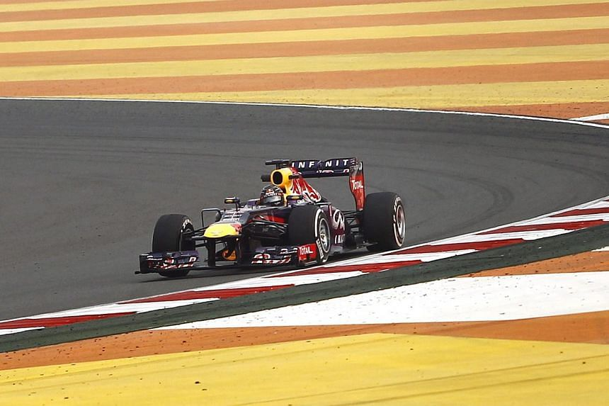 Red Bull Formula One driver Sebastian Vettel of Germany drives during the second practice session of the Indian F1 Grand Prix at the Buddh International Circuit in Greater Noida, on the outskirts of New Delhi on Friday, Oct 25, 2013. Vettel obli