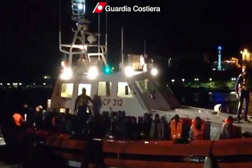 This picture grabbed on a video released by the Guardia Costiera on Friday, Oct 25, 2013, shows immigrants on a boat after their rescue near Lampedusa. Italian navy and coast guard vessels rescued more than 700 migrants in waters between Sicily