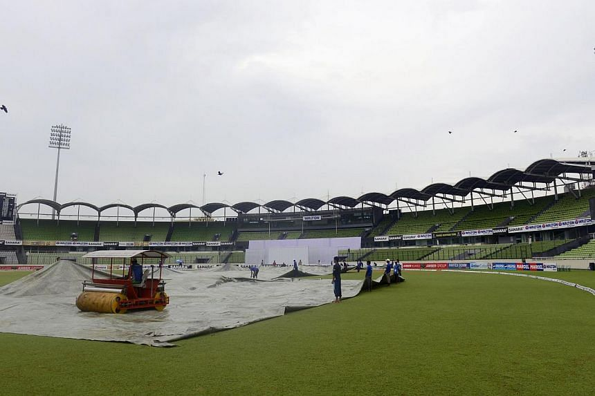 A Bangladeshi groundsman drives a Super Sopper to dry the field following heavy rain at the Sher-e Bangla National Stadium in Dhaka on Friday, Oct 25, 2013. The two-Test series between Bangladesh and New Zealand ended in a draw, after the fifth