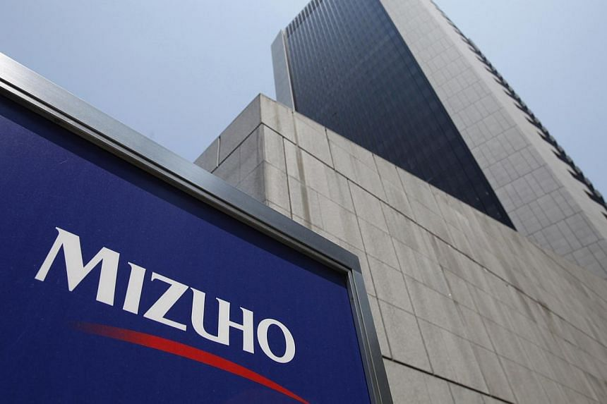 Mizuho Financial Group's Mizuho Bank headquarters is pictured in Tokyo in this May 18, 2011 file photo. Japan's banking regulator on October 9, 2013 ordered Mizuho Financial Group Inc to submit an updated report on its failure to stop loans to organi