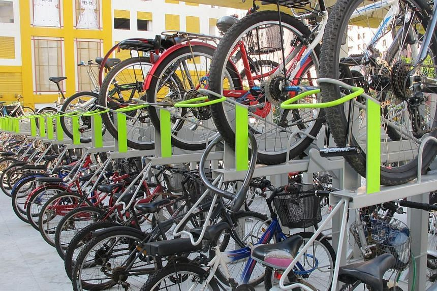 Double-tiered racks installed in the bicycle parking facility next to Sembawang MRT station. Cycling paths will be built at three housing estates - Ang Mo Kio, Choa Chu Kang and Toa Payoh - under a national drive to promote cycling as a cheaper, heal