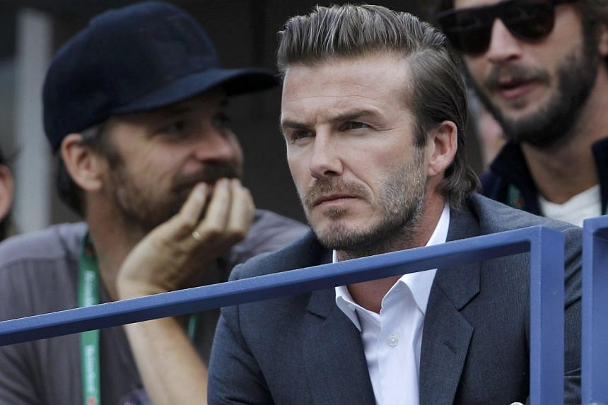 English soccer star David Beckham watches Rafael Nadal of Spain face Novak Djokovic of Serbia in the men's final match at the US Open tennis championships in New York, on Sept 9, 2013. Beckham hailed Alex Ferguson for helping get his career bac