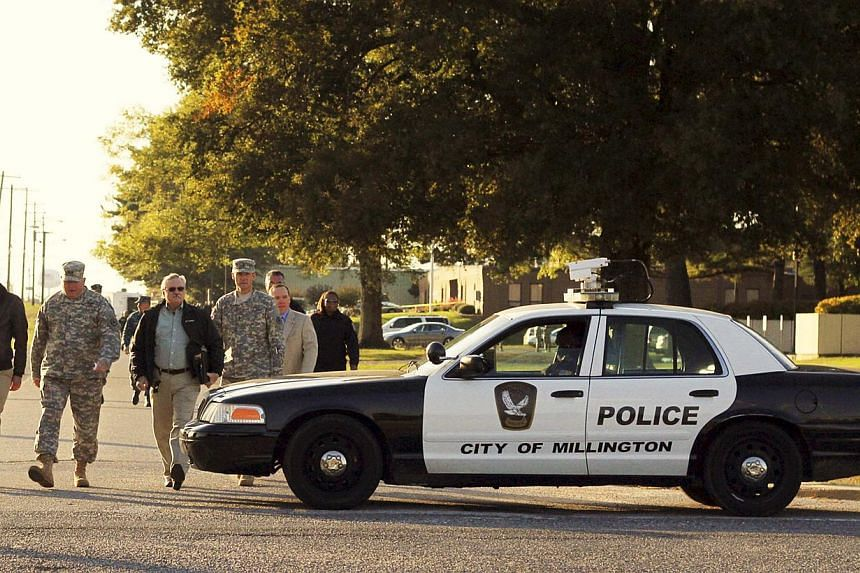 "Major General Terry M. ""Max"" Haston (2nd L), Adjutant General Tennessee National Guard tours the scene of a shooting at the National Guard Armory in Millington, Tennessee October 24, 2013. A National Guard recruiter accused of wounding three sup"