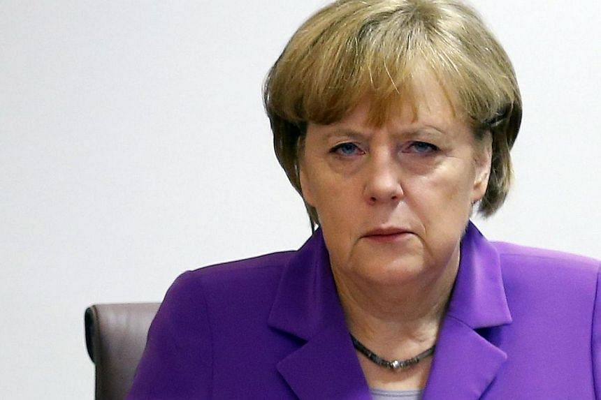 "German Chancellor Angela Merkel attends a meeting entitled ""Cut EU Red Tape"" during the European Union Summit of Heads of States held at the European Union Council building in Brussels on October 25, 2013. German Chancellor Angela Merkel wants t"