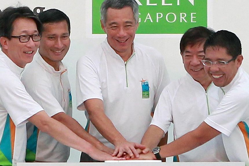 (From left) Minister in the Prime Minister's Office Lim Swee Say, Minister for Environment and Water Resources Vivian Balakrishnan, Prime Minister Lee Hsien Loong, Minister for National Development Khaw Boon Wan and Mayor of the South East District o
