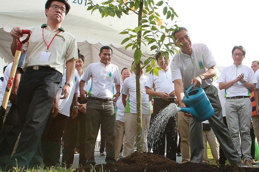 Prime Minister Lee Hsien Loong (third from right) at a tree planting ceremony after officially launching the Clean and Green Campaign 2014 on Oct 26, 2013. With him are Minister in the Prime Minister's Office Lim Swee Say (second from right), Ministe