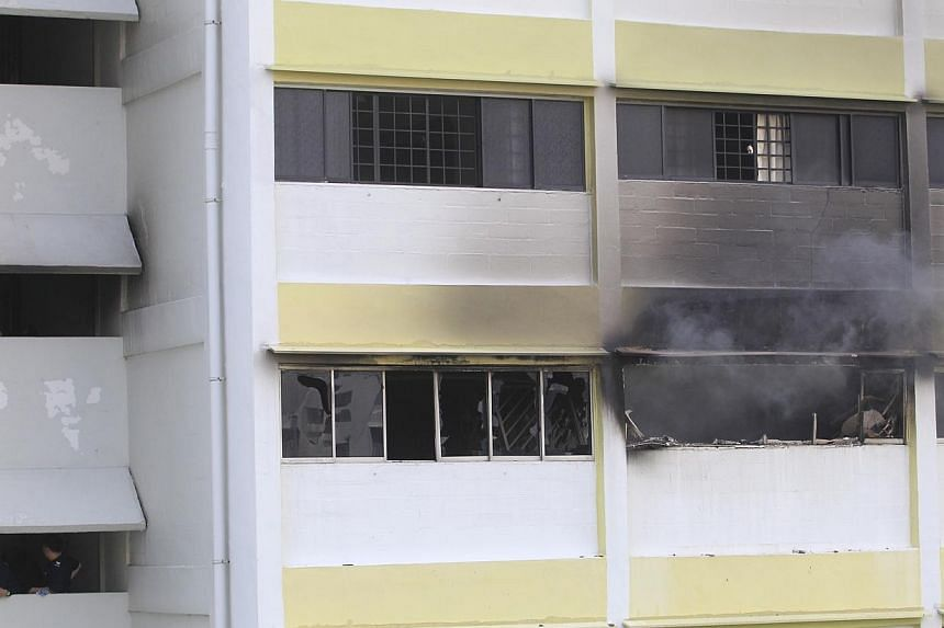 The body of a man was discovered by firefighters after they put out a fire at a Marine Crescent flat on Saturday. -- ST PHOTO: KEVIN LIM