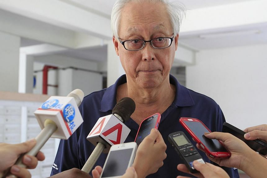 Emeritus Senior Minister Goh Chok Tong, who is also MP for Marine Parade GRC was at the scene with other grassroots leaders to assist residents affected by the fire. -- ST PHOTO: KEVIN LIM