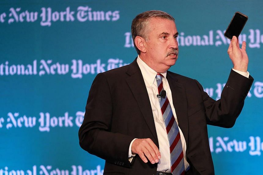 Thomas Friedman speaks during The New York Times Global Forum held at The Four Seasons Singapore on Oct 25, 2013. -- ST PHOTO: NEO XIAOBIN