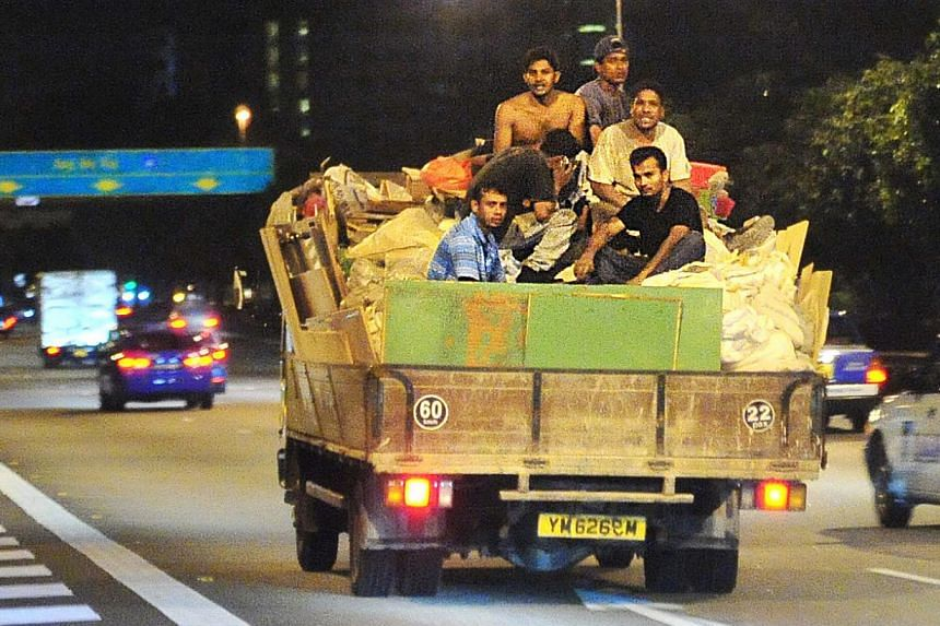 KEEPING TO THE LIMIT: While most lorry loads keep within the designated passenger loads, an increasing number are violating the maximum limit.  GOING DOWN: Unsafe practices, such as these workers sitting atop a pile of cargo on a lorry (left) in 2009