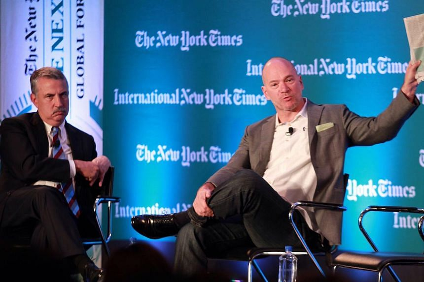 Dr McAfee (right) speaking at the NYT Global Forum Asia yesterday, with moderator Thomas Friedman beside him. Dr McAfee read from an ST report on how the Singapore Institute of Technology wished to turn its students into ''thinking tinkerers'', and s