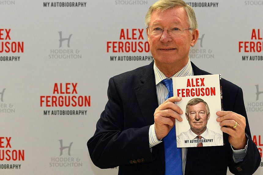Former Manchester United manager Alex Ferguson poses for pictures with his new book My Autobiography before a signing at a supermarket in Manchester, north-west England, on Oct 24, 2013. Arsenal manager Arsene Wenger on Friday said he wouldn't be sur