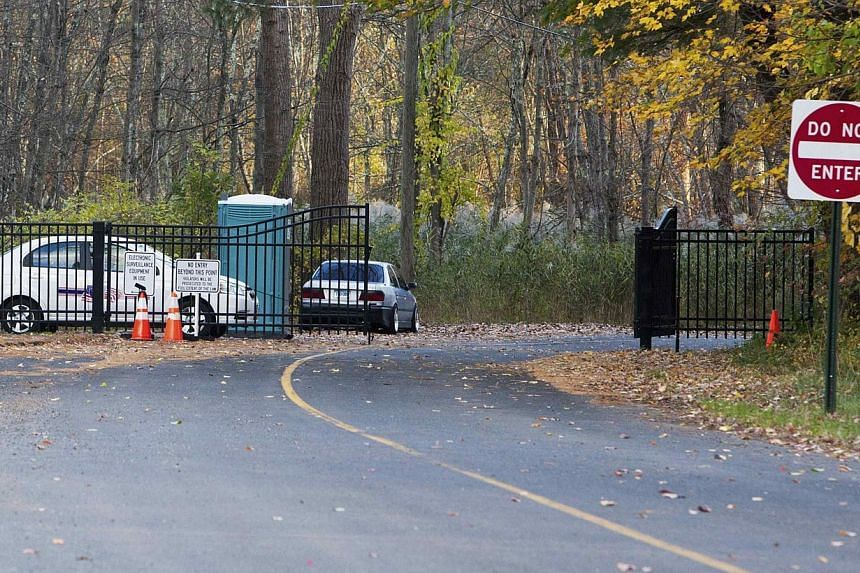 Gates block the roadway leading to Sandy Hook Elementary School in Newtown, Connecticut on Oct 24, 2013. Demolition work has begun on a US elementary school where 20 children and six adults were killed during a massacre last December, an official sai