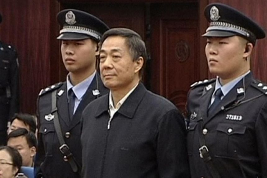 Bo Xilai (centre) stands as the decision of his appeal is announced at the Shandong Higher People's Court in Jinan, capital of east China's Shandong province, in this still image taken from video on Friday, Oct 25, 2013. Chinese state media laid into