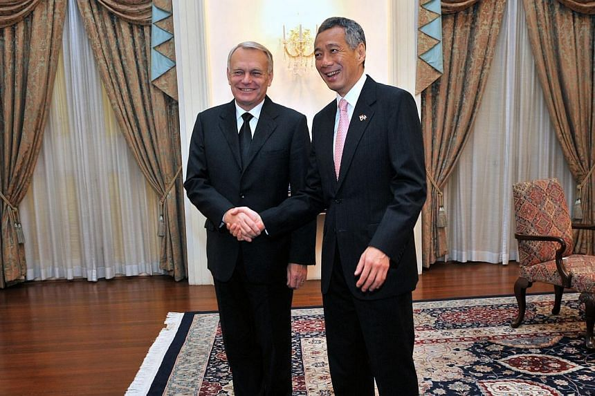 Prime Minister Lee Hsien Loong (right) and French Prime Minister Jean-Marc Ayrault shake hands in the Istana in this photograph taken last year.Mr Lee will make an official visit to France and Poland from Oct 27 to Nov 1. In France, he will mee