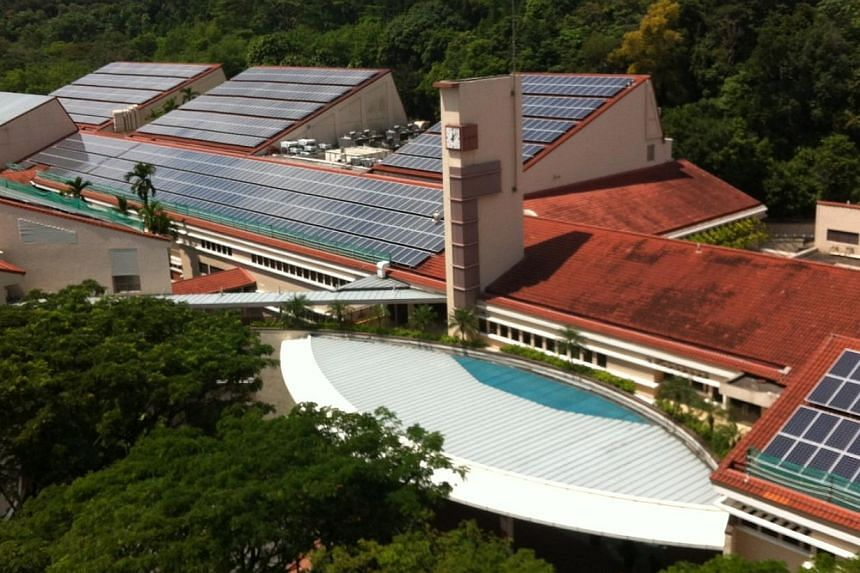 The Singapore American School in Woodlands has installed a 1-megawatt-peak (MWp) solar panel system on its roof, one of the largest single-site installations here and the largest on a school campus. -- PHOTO: SINGAPORE AMERICAN SCHOOL