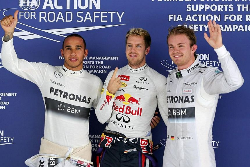 Red Bull driver Sebastian Vettel of Germany (centre), Mercedes AMG Petronas driver Nico Rosberg of Germany (right) and Mercedes AMG Petronas driver Lewis Hamilton (left) after qualifying first, second and third for the start of the Formula OneG