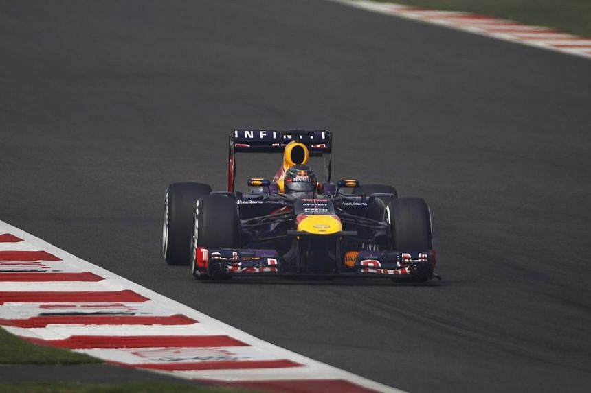 Red Bull Formula One driver Sebastian Vettel of Germany drives during the qualifying session of the Indian Formula One Grand Prix at the Buddh International Circuit in Greater Noida, on the outskirts of New Delhi, on Saturday, Oct 26, 2013. -- PHOTO: