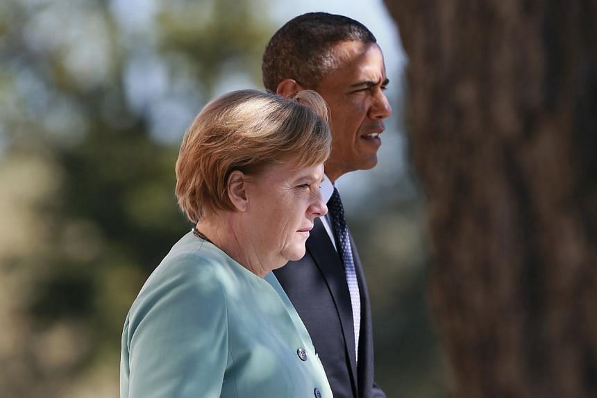 US President Barack Obama (right) was personally informed of mobile phone tapping against German Chancellor Angela Merkel, which may have begun as early as 2002, German media reported on Sunday, Oct 27, 2013. -- FILE PHOTO: REUTERS