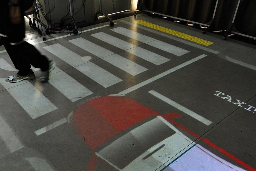 Singapore Polytechnic and the Agency of Integrated Care and Temasek Cares have come up with a floor projection system that will help the elderly in road-crossing scenarios. Ceiling-mounted cameras will track the motion of the subject via sensors atta