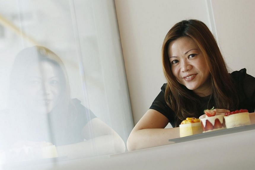 Pastry chef-owner of The Audacious Cakery, Ms Sharryl Ng, serves French-style mousse cakes, cupcakes, tarts and pastries such as croissants. -- PHOTO: DESMOND LUI FOR THE SUNDAY TIMES