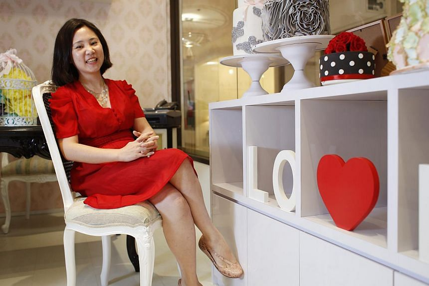 Ms Joan Chien (above) specialises in custom-designed fondant and buttercream cakes and also does dessert tables for events. -- PHOTO: DESMOND LUI FOR THE SUNDAY TIMES