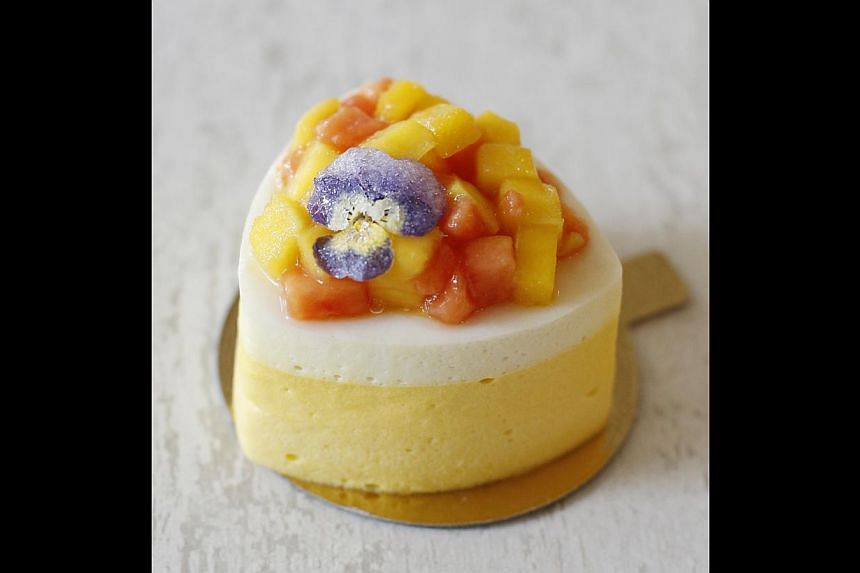 The Exotique, mango and coconut mousse on a jaconde sponge decorated with fresh mango and papaya. -- PHOTO: DESMOND LUI FOR THE SUNDAY TIMES
