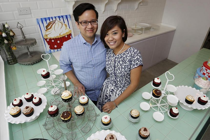 On the menu at Fluff Bakery, set up by Mr Ashraf Alami and his wife, Ms Nursyazanna Syaira Mohammad Suhimi (both above), is chocolate Nutella cinnamon vertical cake. -- PHOTO: DESMOND LUI FOR THE SUNDAY TIMES