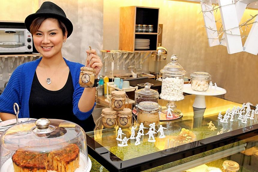 The Tiramisu Hero, co-owned by Ms Peggy Chang (above), offers tiramisu in a jar in flavours such as strawberry, Milo and Horlicks, while L'Atelier TiramiSu, run by Mrs Judith Josset, her son Sherwin and his girlfriend Amelia, serves the dessert in