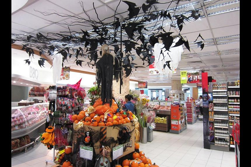 Cold Storage (above) is all decked up for Halloween, with pumpkins in many sizes and ghoulish products for sale. -- PHOTO: COLD STORAGE