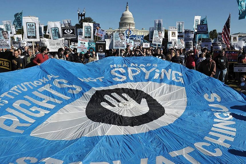 A large banner calling for an end to government surveillance is seen during a protest on Oct 26, 2013, infront of the US Capitol in Washington, DC. -- PHOTO: AFP