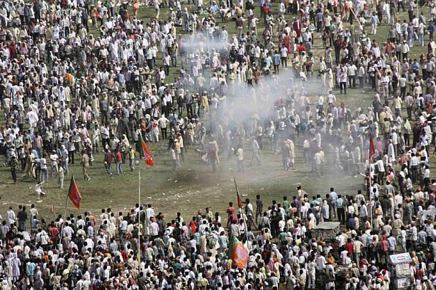 Smoke rises after a bomb exploded near a public ground where Gujarat's chief minister and Hindu nationalist Narendra Modi, the prime ministerial candidate for India's main opposition Bharatiya Janata Party (BJP), was to address a rally in the eastern