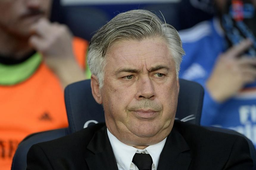 Real Madrid's coach Carlo Ancelotti from Italy looks on prior to the Spanish La Liga soccer match against FC Barcelona at the Camp Nou stadium in Barcelona, Spain, Saturday, Oct 26, 2013. Real Madrid boss Carlo Ancelotti has backed Gareth Bale to com