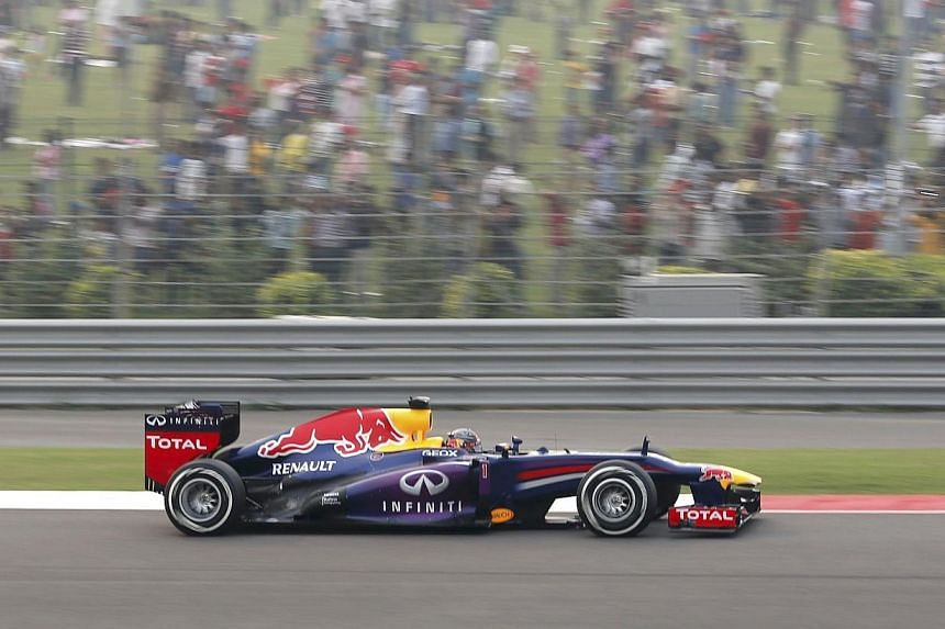 Red Bull Formula One driver Sebastian Vettel of Germany drives during the Indian Formula One Grand Prix at the Buddh International Circuit in Greater Noida, on the outskirts of New Delhi, on Sunday, Oct 27, 2013. -- PHOTO: REUTERS