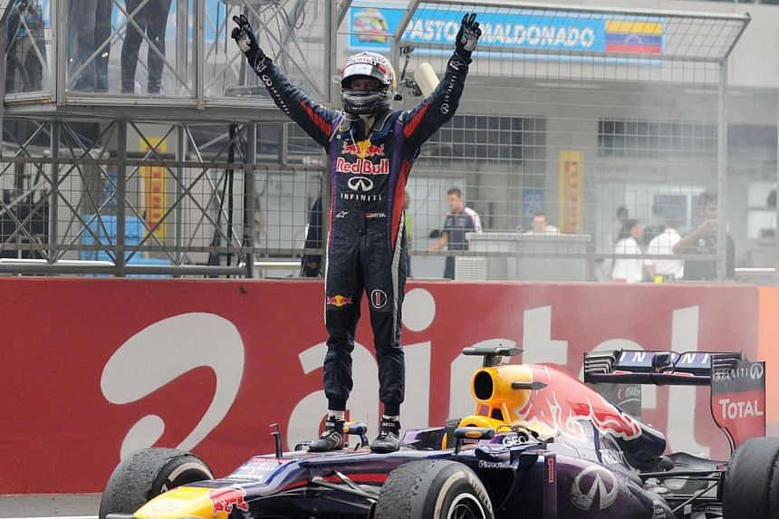 Red Bull driver Sebastian Vettel of Germany celebrates after winningthe Indian Formula One Grand Prix at the Buddh International Circuit in Greater Noida, on the outskirts of New Delhi, on Sunday, Oct 27, 2013. -- PHOTO: AFP
