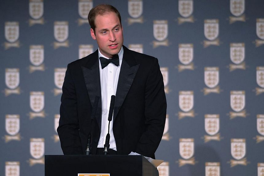 Britain's Prince William talks on stage during the FA150 Gala Dinner commemorating the Football Association's 150th year at the Grand Connaught Rooms in London, Oct 26, 2013. Footballers need support to help them handle the pressure that comes with t