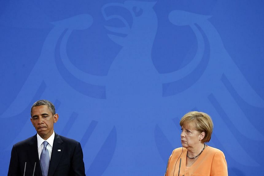 United States President Barack Obama and German Chancellor Angela Merkel holding a joint news conference at the Chancellery in Berlin on June 19, 2013. The imbroglio over the tapping of Ms Merkel's phone deepened on Oct 27, after a US denial that Mr