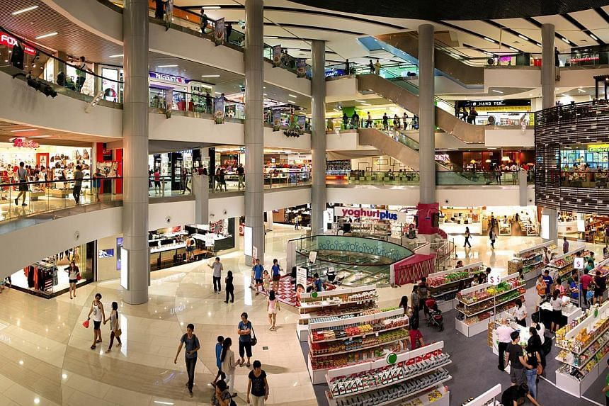 "OCBC Investment Research has upgraded its call on Frasers Centrepoint Trust, which owns suburban malls such as Causeway Point (above), from ""hold"" to ""buy"". -- PHOTOS: FRASERS"