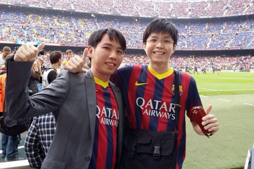 Lionel Messi fans Mervyn Sng (left), 31, and Ng Hong Ming, 24, at the live match between Barcelona and Real Madrid at Camp Nou stadium in Spain. The two lucky readers won an all-expenses-paid trip sponsored by Samsung for their winning entries in The