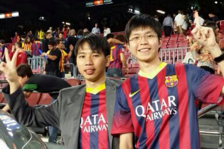 Lionel Messi fans Mervyn Sng (left), 31, and Ng Hong Ming, 24, at the live match between Barcelona and Real Madrid in Spain. -- PHOTO: NG HONG MING