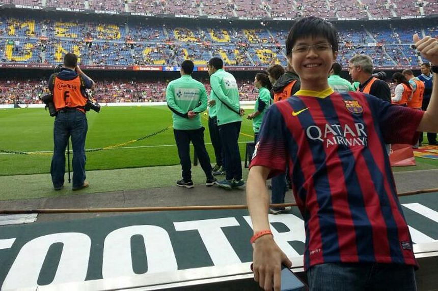 """Lionel Messi fan Ng Hong Ming, 24, at the live match between Barcelona and Real Madrid in Spain. The Nanyang Technological University student wrote a poem on Lionel Messi being in """"top condition"""" which won him an all-expenses-paid trip sponsored by S"""