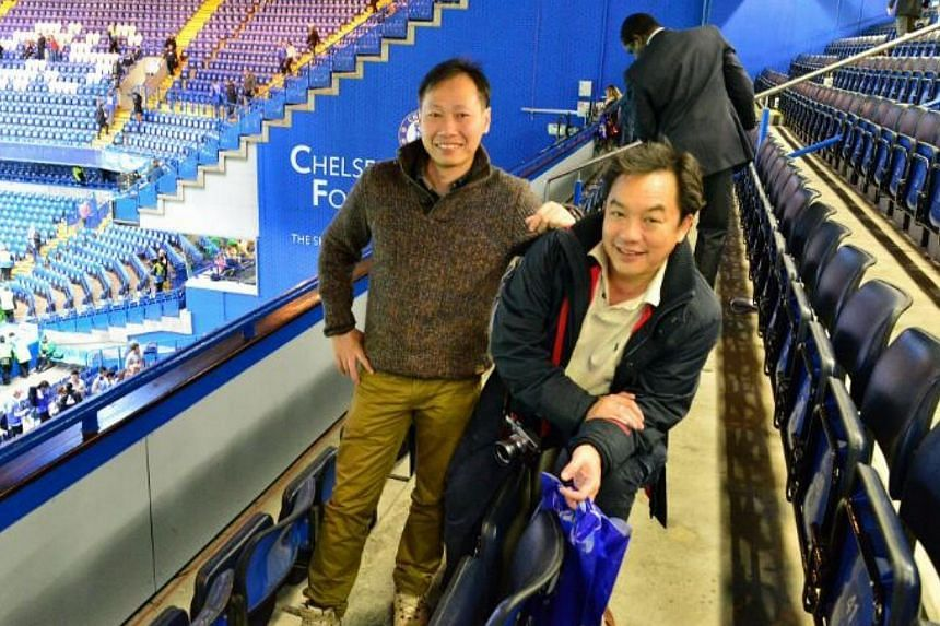 Engineering manager Tung Hon Keng (left), 47, and his travel partner Mr Peter Chang at the live match between Chelsea and Manchester City at Stamford Bridge in London. -- PHOTO:TUNG HON KENG